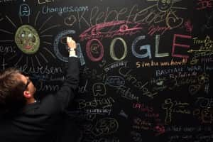 BERLIN, GERMANY - SEPTEMBER 26: A visitor writes on a chalkboard on September 26, 2012 at the official opening party of the Google offices in Berlin, Germany. Although the American company holds 95% of the German search engine market share and already has offices in Hamburg and Munich, its new offices on the prestigious Unter den Linden avenue are its first in the German capital. The Internet giant has been met with opposition in the country recently by the former president's wife, who has sued it based on search results for her name that she considers derogative.  The European Commission has planned new data privacy regulations in a country where many residents opted in to have their homes pixeled out when the company introduced its Street View technology.  (Photo by Adam Berry/Getty Images)