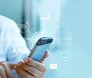 Man using mobile payment, holding circle global and icon customer network connection, Omni Channel or Multi channel