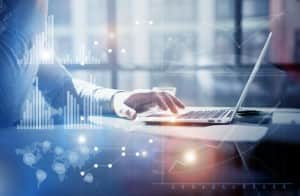 Business concept photo.Businessman working investment project modern office.Touching pad contemporary laptop. Worldwide connection technology,stock exchanges graphics interface.